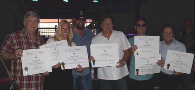 Toby Keith accepting awards with BMI team.
