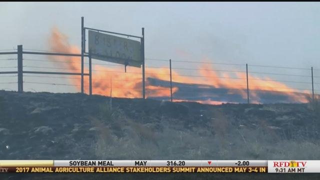 A wildfire burns ranch land on the plains.