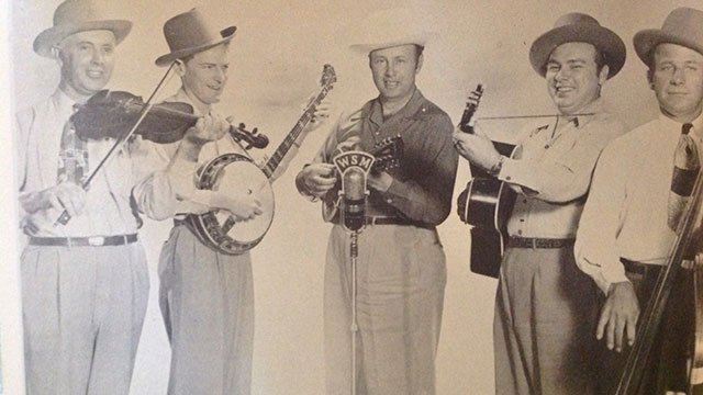 Bill Monroe and His Bluegrass Boys, c.1949. Mac Wiseman is 2nd from right, holding a guitar.