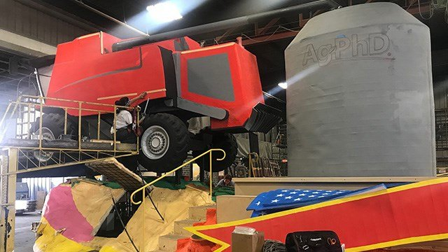 A silo and tractor are part of the Ag PhD float.