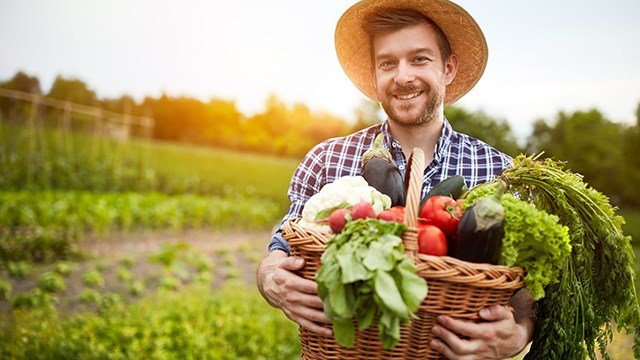 A farmer with a basket of produce.