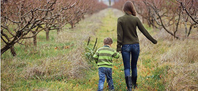 young mom and son in rural setting
