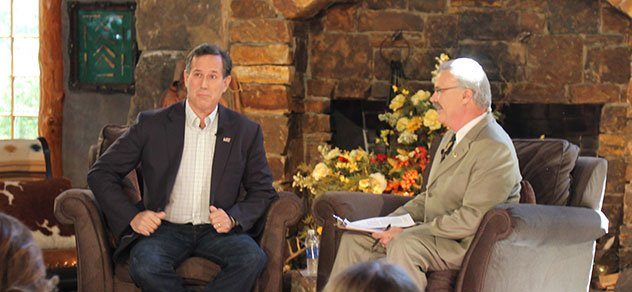 Presidential candidate Rick Santorum shares a laugh with Mark Oppold on RURAL TOWN HALL.