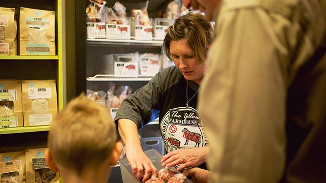 Heather Dineen packages some of the family's farm-to-table products.