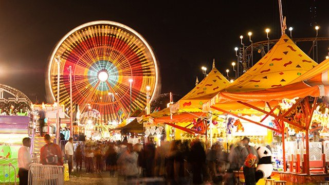 A state fair midway at night.