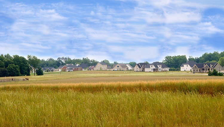 Residential development encroaching upon farmland.