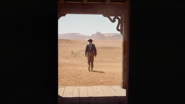 "John Wayne walks away in the last scene from ""The Searchers."""