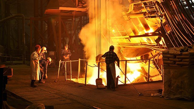 Workers at a steel mill.