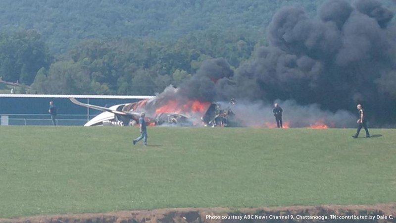 A plane that had been carrying NASCAR driver Dale Earnhadt Jr. burns following a crash.