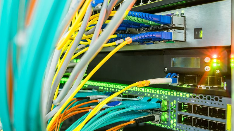 Cables plugged into a central router in a data center