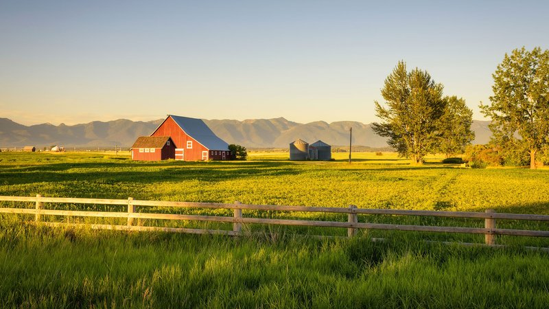 Farm land with a red barn.